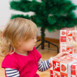 Little Girl Opens Gift — Stock Photo #40479993
