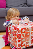 Little Girl Opens the Gift — Stock Photo
