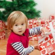 Little Girl Opens Gift — Stock Photo #40480615