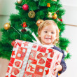 Little Girl Holding a Christmas Gift — Stock Photo