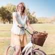 Happy Young Woman with Bicycle — Stock Photo