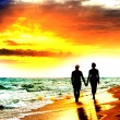 Stock Photo: Couple Walk on the Beach