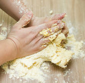 Kneading Dough on the Kitchen Table — Stock Photo