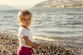 Little girl by river — Stock Photo