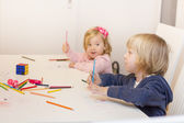 Little girl and boy drawing with colorful crayons — Stock Photo