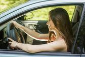 Beautiful young woman driving a car — Stock Photo