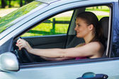 Happy young woman driving a car — Stock Photo