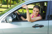 Woman showing keys of new car — ストック写真