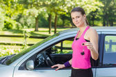 Woman showing keys of new car — Stock Photo