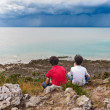 Kids Looking at a Storm over the Sea — Photo