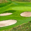 Stock Photo: Golf sand traps on the green grass