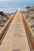 Rails for rescue ship in Goury, Normandy — Stock Photo