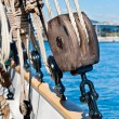 Ancient wooden sailboat pulley and ropes detail - Stock Photo