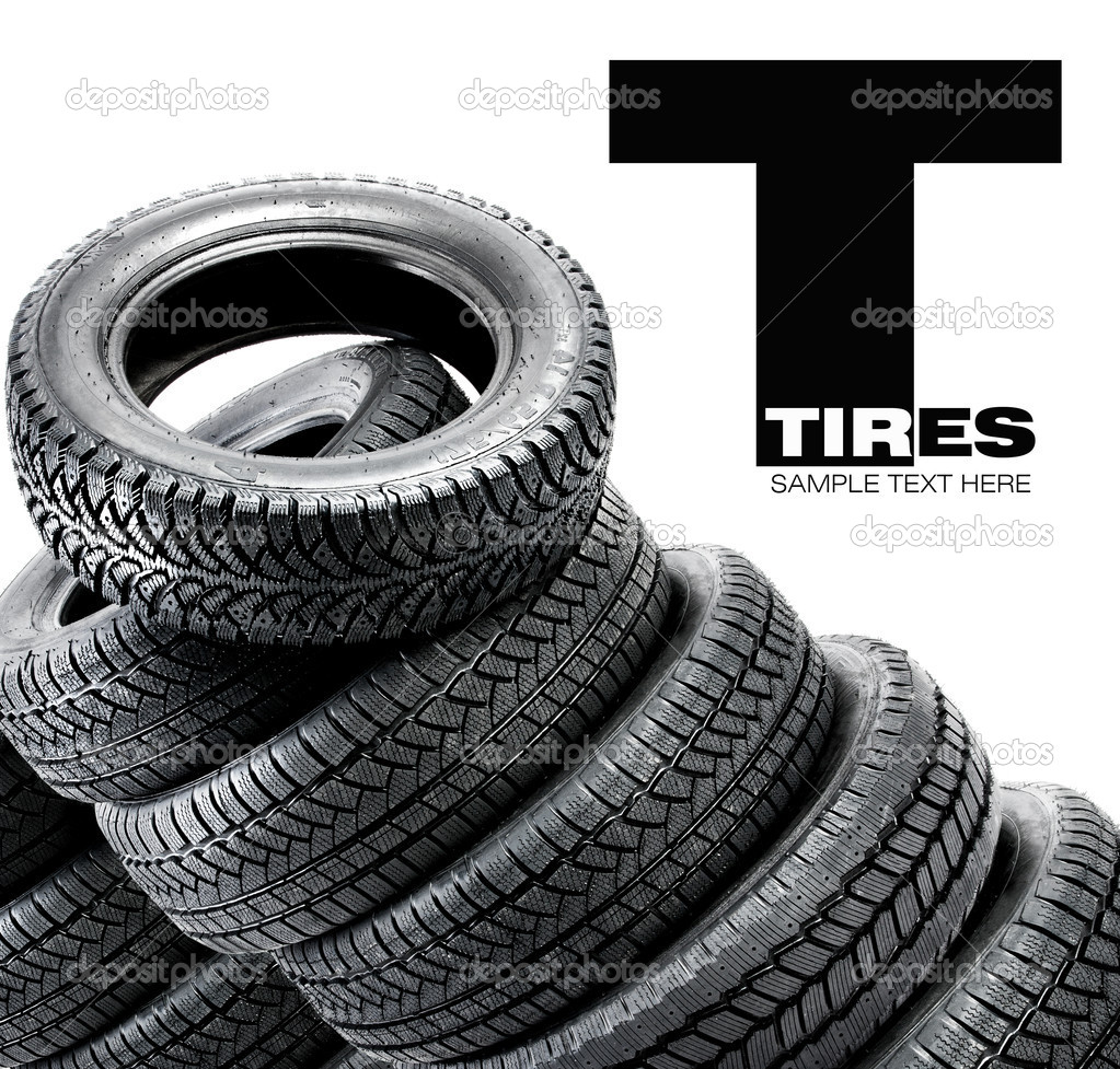 Pyramid of tires isolated on the background — Stock Photo #13513221