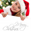 Stock Photo: Pretty blond hair girl with santa hat