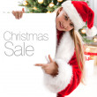 Pretty blond hair girl with santa hat — Stock Photo