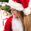 Beautiful young girl in Santa Claus clothes — Stock Photo #16029597
