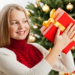 Beautiful young blonde girl holds present — Stock Photo