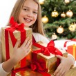 Beautiful young blonde girl holds presents — Stock Photo