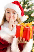 Beautiful young girl in Santa Claus clothes — Stock Photo