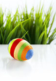 Easter egg covered with colorful woolen yarn — Stock Photo