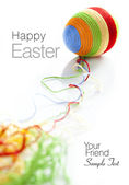 Colorful wool yarns unwraped from easter egg — Stock Photo