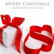 White gift box with red ribbon — Stock Photo #37140687