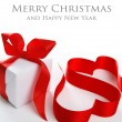 Stock Photo: White gift box with red ribbon