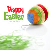 Easter egg covered with various colors wool — Stock Photo