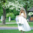 First Communion - girl looks at her gifts — Stock Photo