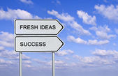 Road sign to fresh ideas and success — Stock Photo
