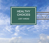 Road sign to healthy choices — Stock Photo