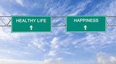 Road sign to healthy life and happiness — Stock Photo