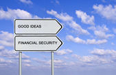 Road sign to good idea and financial security — Stock Photo