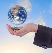 Planet earth on palms.Elements of this image furnished by NASA — Stock Photo