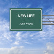 Road sign to new life - Stock Photo