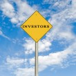 Stock Photo: Road sign to investors