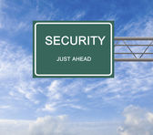 Road sign to security — Stock Photo