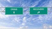 Road sign to recovery and crisis — Stock Photo