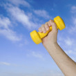 Dumbbell in hand — Stock Photo