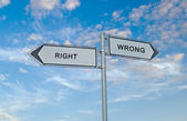 Road sign to right and wrong — Stock Photo