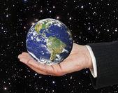 Planet earth on palm.Elements of this image furnished by NASA — Stock Photo