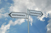 Road sign to independence and occupation — Stock Photo