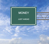 Road sign to money — Stock Photo