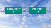 Road signs to good and bad credit — Stock Photo