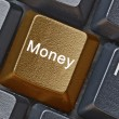 Keyboard with key for money — Stock Photo #30680043