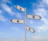 Road sign to currencies — Stock Photo