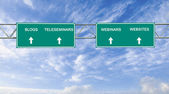 Road sign to blogs,teleseminars,webinars, and websites — Stock Photo