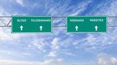 Road sign to blogs,teleseminars,webinars, and websites — Stock Photo