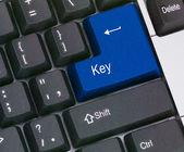 Tangentbord med blå knapp — Stockfoto